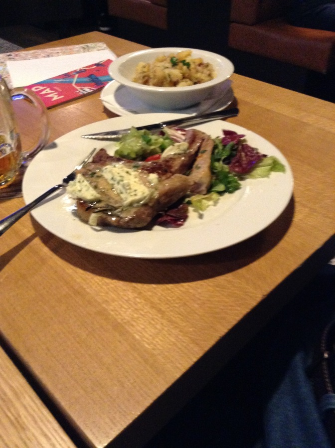 Norm's favorite! A delicious pork chop with smashed potatoes.
